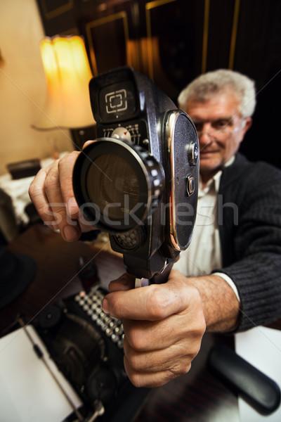 Senior Man Holding Video Camera Stock photo © MilanMarkovic78