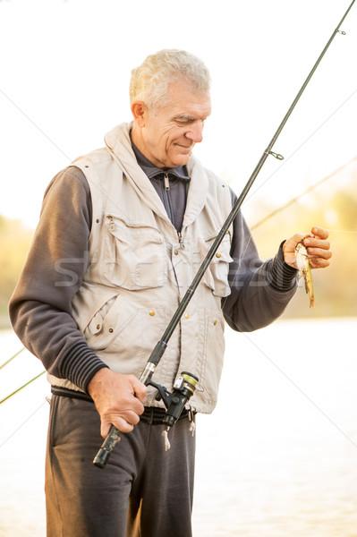 Halász idős tart horgászbot hal kampó Stock fotó © MilanMarkovic78