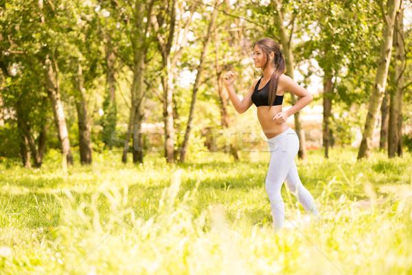 ジョギング 幸せ 小さな 美人 を実行して 公園 ストックフォト © MilanMarkovic78