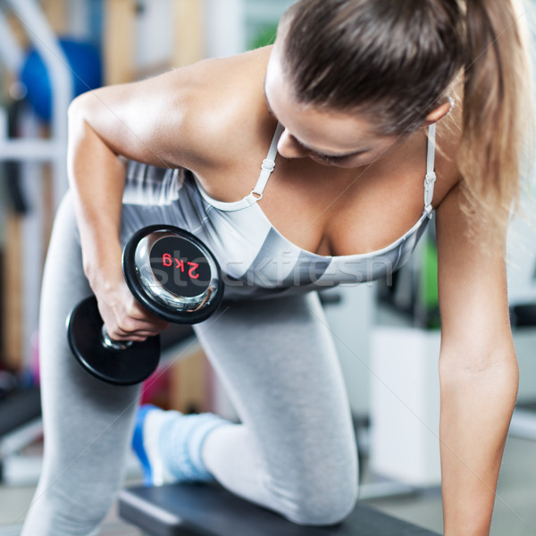 Young woman doing back exercise Stock photo © MilanMarkovic78