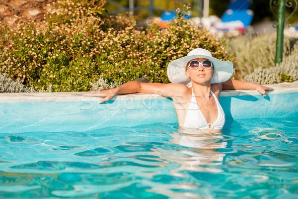 Сток-фото: бассейна · привлекательный · солнце · женщину
