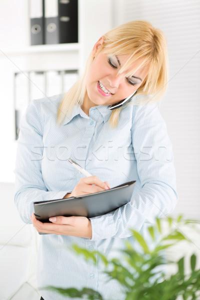 女性実業家 忙しい 美しい 携帯電話 オフィス 女性 ストックフォト © MilanMarkovic78