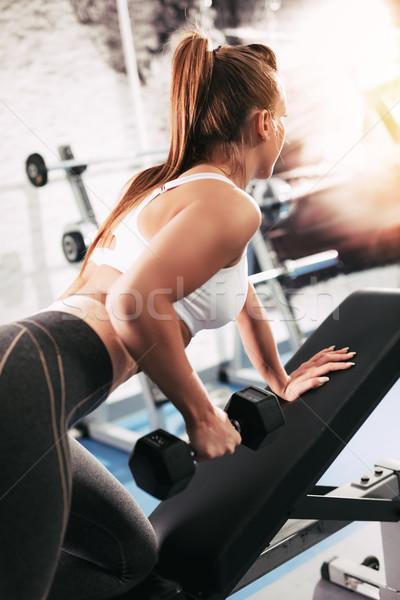 Girl Exercising At The Gym Stock photo © MilanMarkovic78