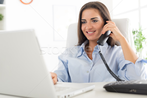 Business Woman Phoning In Office Stock photo © MilanMarkovic78