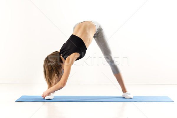 Flexible Girl Doing Stretching Exercises Stock photo © MilanMarkovic78