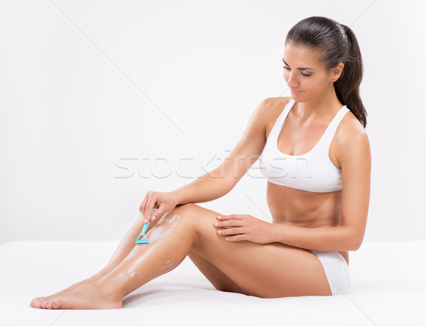 Shaving leg Stock photo © MilanMarkovic78