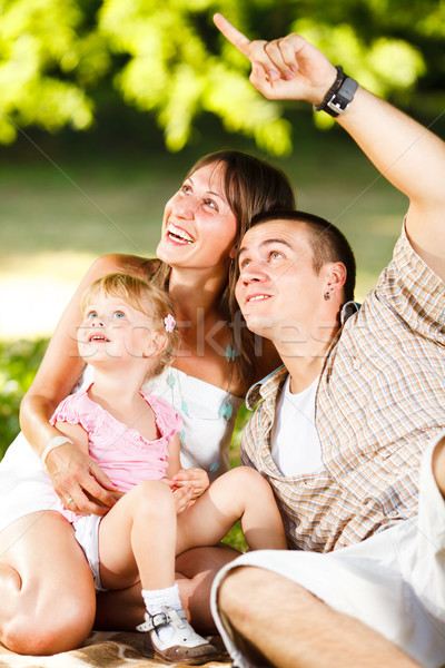 Happy family having fun in the park Stock photo © MilanMarkovic78