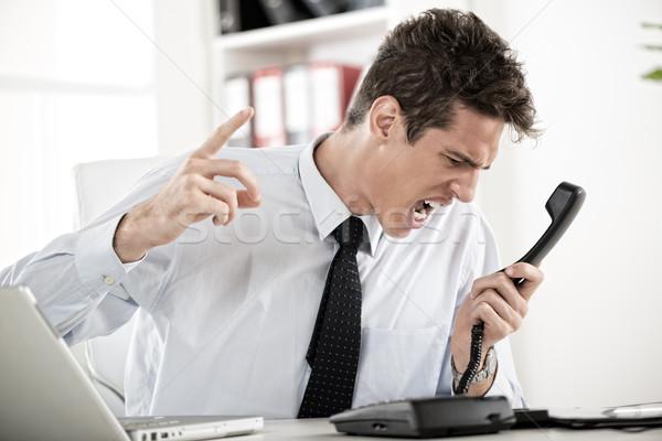 Mérges üzletember fiatal ül iroda sikít Stock fotó © MilanMarkovic78