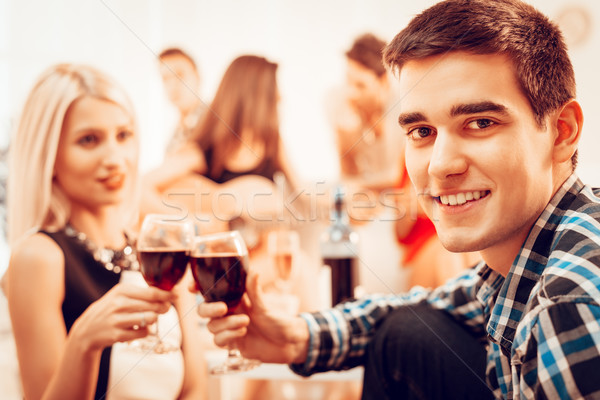 Young Couple Are Toasting Stock photo © MilanMarkovic78