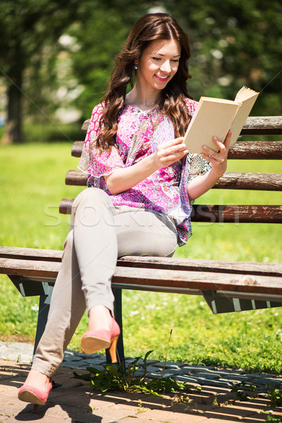 Stock photo: Woman Reading Book In The Park