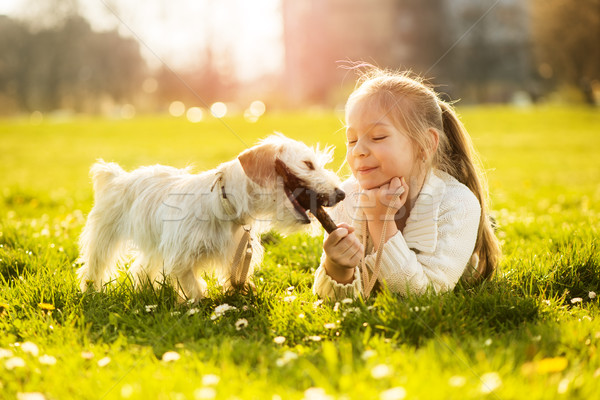 Stock photo: Little girl with her puppy dog