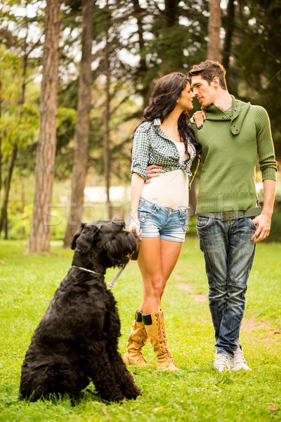 Young Couple With Dog Stock photo © MilanMarkovic78