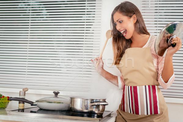 Girl Cooking Stock photo © MilanMarkovic78