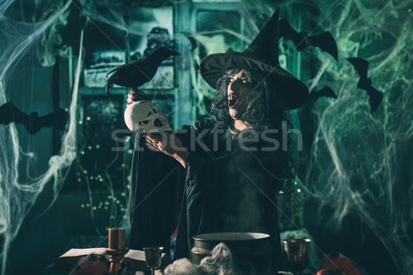 Witch Tells Magic Words To Skull Stock photo © MilanMarkovic78
