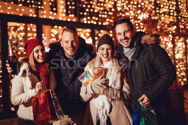 Stock photo: Happy Friends Shopping In Holiday Season
