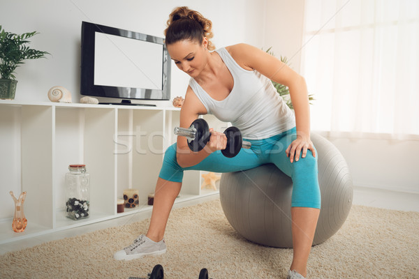 Exercising With Dumbbell At Home Stock photo © MilanMarkovic78