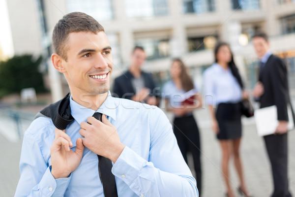 Zdjęcia stock: Młodych · szczęśliwy · biznesmen · uśmiechnięty · stałego