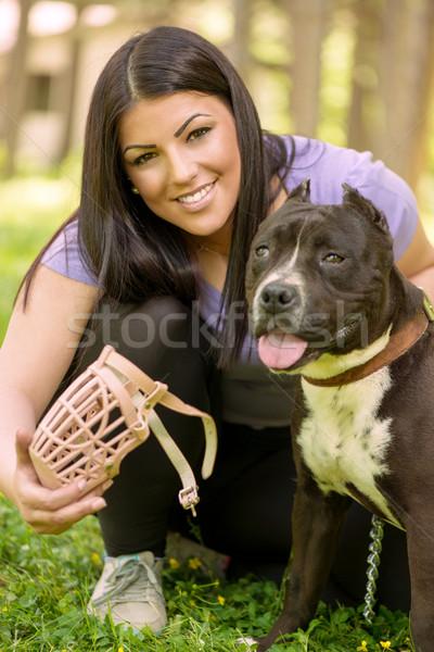 Dziewczyna psa piękna młoda kobieta kaganiec koszyka Zdjęcia stock © MilanMarkovic78