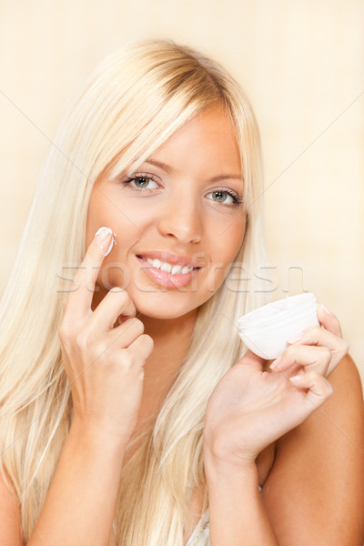 Beautiful Woman Applied Face Cream Stock photo © MilanMarkovic78