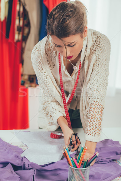 Female Tailor Cutting Material Stock photo © MilanMarkovic78
