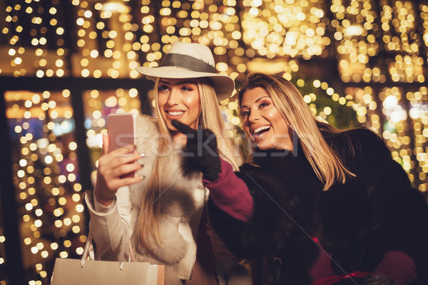 Stock photo: Two Sisters At The City In Holiday Time