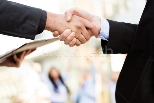 Affaires face mains deux hommes d'affaires serrer la main Photo stock © MilanMarkovic78