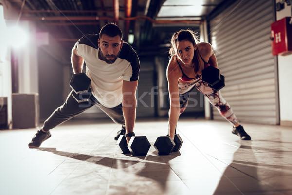 Casal atravessar treinamento jovem muscular força Foto stock © MilanMarkovic78