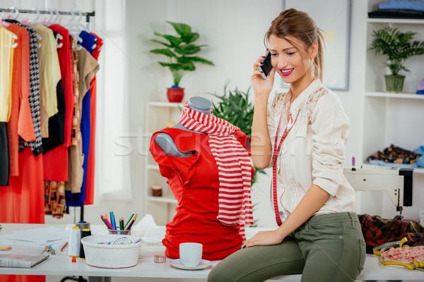 Fashion Designer With Mobile Phone Stock photo © MilanMarkovic78