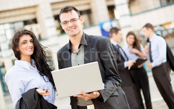 小さな 同僚 ノートパソコン ビジネスマン 女性実業家 立って ストックフォト © MilanMarkovic78