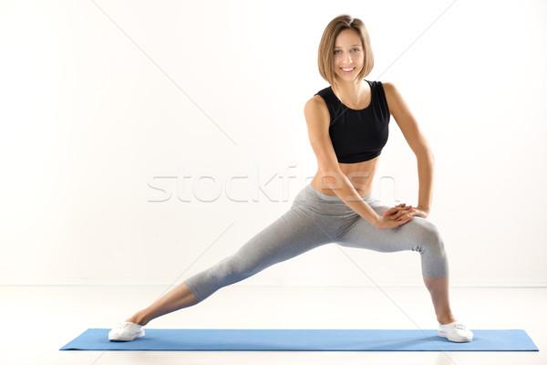 Csinos fitnessz oktató lány sportok ruházat Stock fotó © MilanMarkovic78