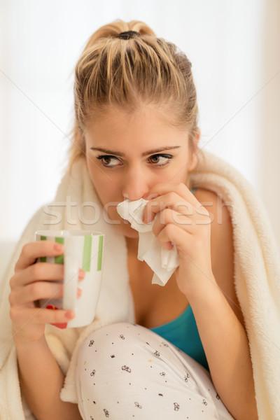 Beautiful girl lenço nariz copo chá Foto stock © MilanMarkovic78