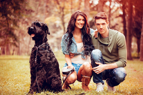 Young Couple With Schnauzer Stock photo © MilanMarkovic78
