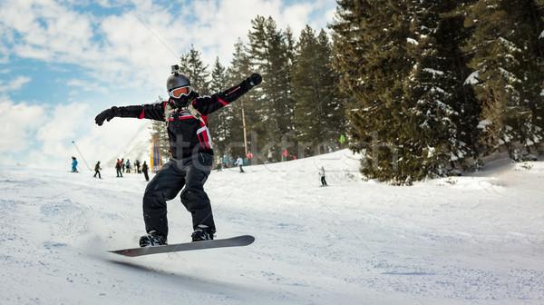 Snowboarder jumping montagna sereno inverno Foto d'archivio © MilanMarkovic78