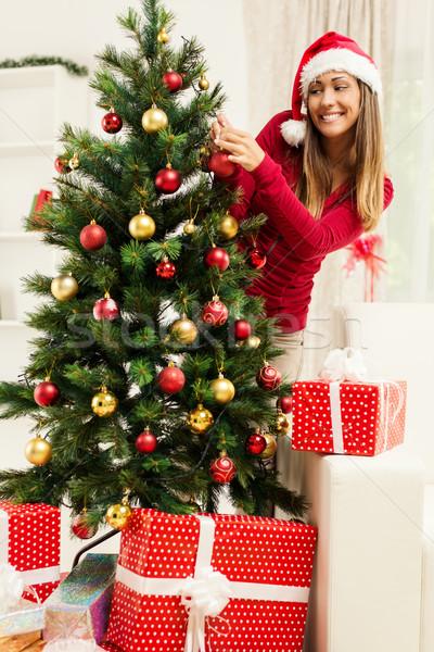 Lány karácsonyfa boldog gyönyörű fiatal nő otthon Stock fotó © MilanMarkovic78