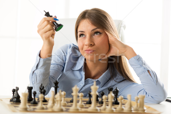 Young Pretty Businesswoman With Chessmen Stock photo © MilanMarkovic78