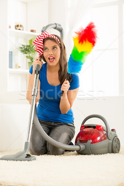 Housewife With Vacuum Cleaner And Duster Stock photo © MilanMarkovic78
