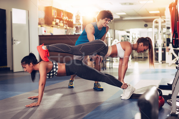 Female Friend Exercising With Instructor Stock photo © MilanMarkovic78