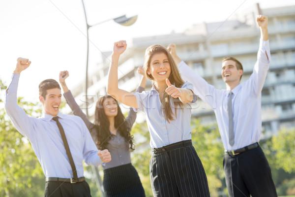 Gagner équipe commerciale jeunes femme d'affaires équipe célébrer Photo stock © MilanMarkovic78