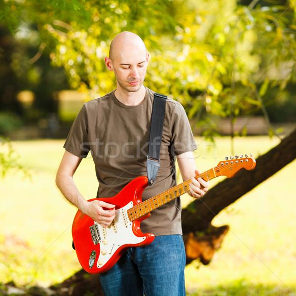 Gitarist genç oynama gitar güzel doğa Stok fotoğraf © MilanMarkovic78