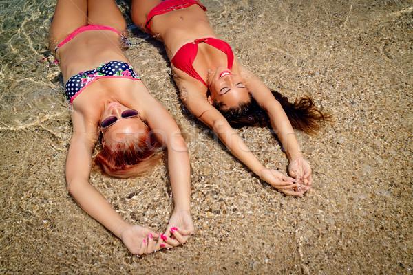 Two Girls On The Beach Stock photo © MilanMarkovic78