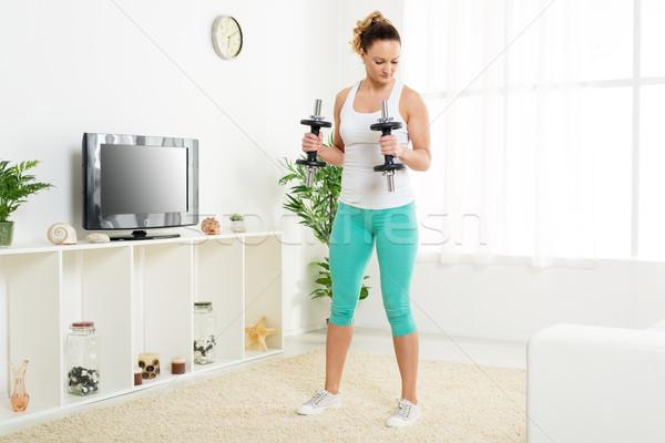 Femme belle jeune femme exercice triceps Photo stock © MilanMarkovic78