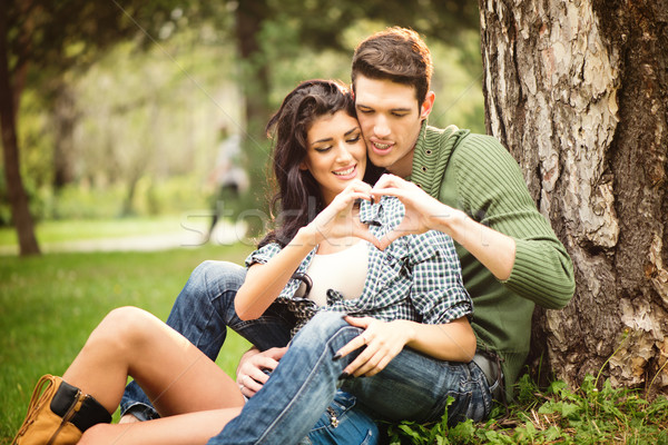 Couple Sitting On The Grass In The Park Stock photo © MilanMarkovic78