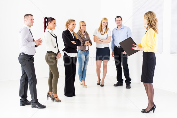 Businesswoman Demonstrating Plan of work Stock photo © MilanMarkovic78