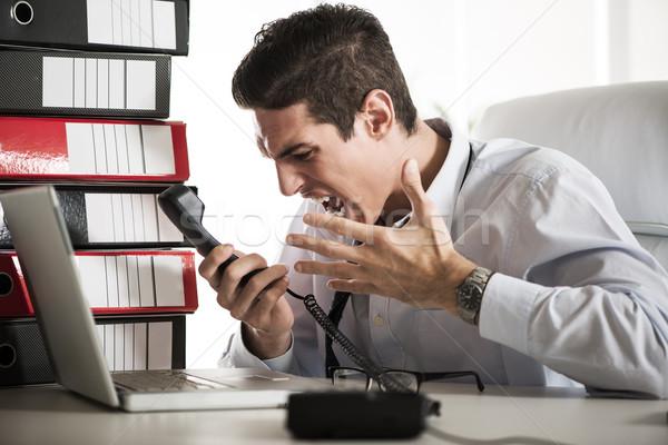 Imprenditore giovani arrabbiato seduta ufficio Foto d'archivio © MilanMarkovic78