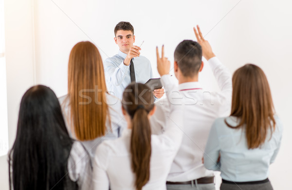 Businessman Answering The Questions Stock photo © MilanMarkovic78