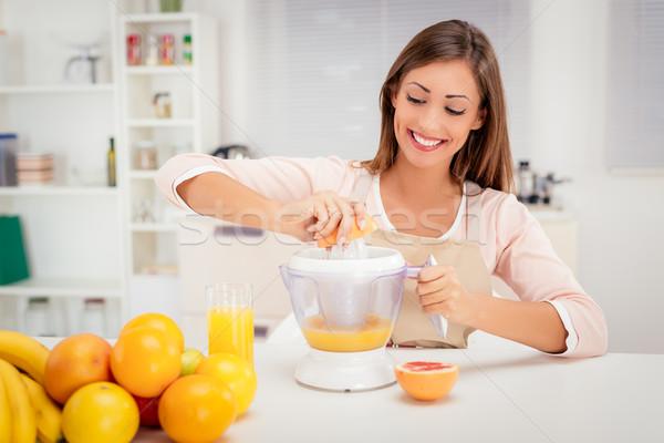 Girl Preparing Healthy Juice Stock photo © MilanMarkovic78