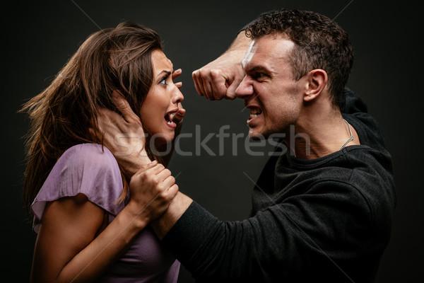 Huiselijk geweld boos agressief echtgenoot vrouw man Stockfoto © MilanMarkovic78