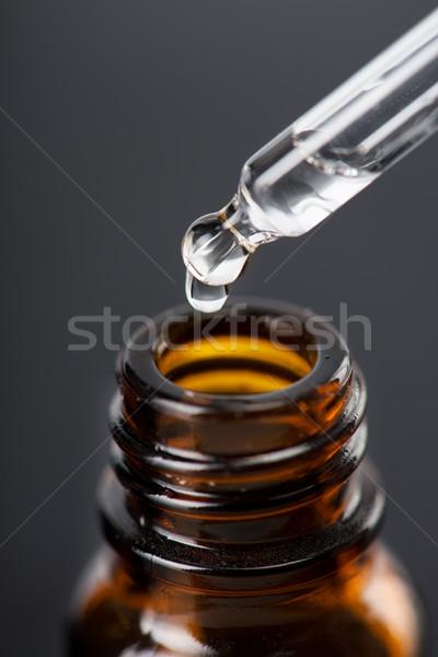 существенный жидкость коричневый стекла бутылок капли Сток-фото © MilanMarkovic78