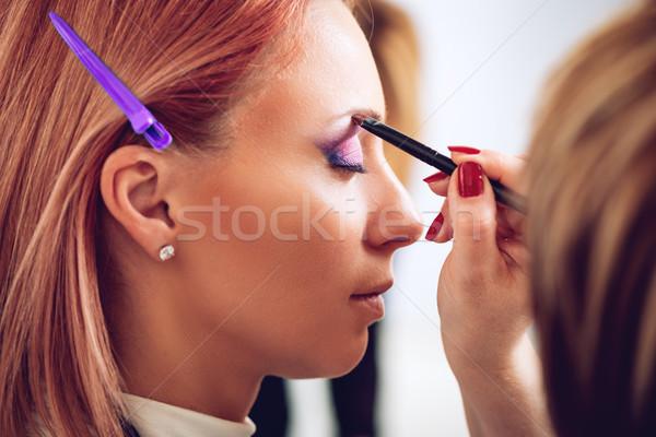 Sminkmester jelentkezik szemöldök smink modell közelkép Stock fotó © MilanMarkovic78