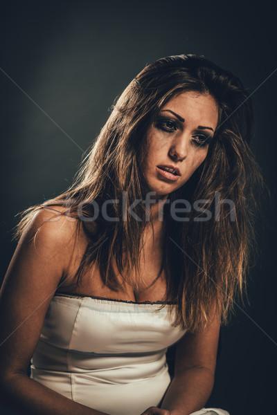 Délelőtt áldozat fiatal magány nő ül Stock fotó © MilanMarkovic78